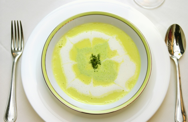Bowl of vegetable soup, white background